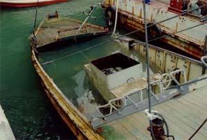 Črpanje vode iz čolna